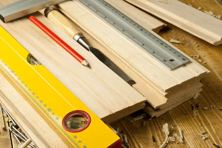Carpenters tools are on a wooden planks Stock Photo