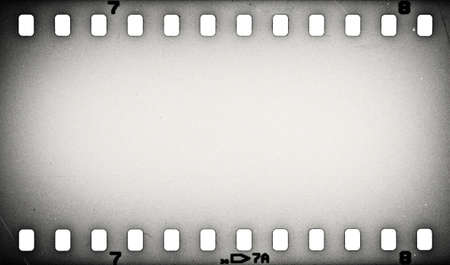 old film: Old grunge film strip background Stock Photo