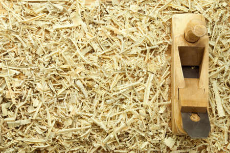 handtool: Carpenters plane on a sawdust and wooden planks Stock Photo