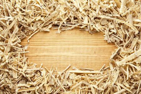Wooden sawdust and shavings background with space for text photo