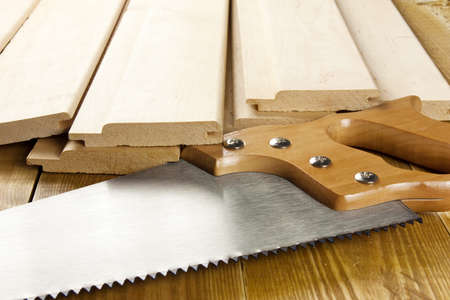 Carpenter's saw is on a woode planks Stock Photo - 13308666