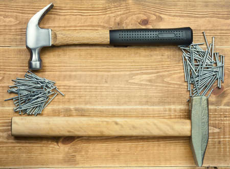 Hammer and nails are on a wooden planks Stock Photo - 13507530