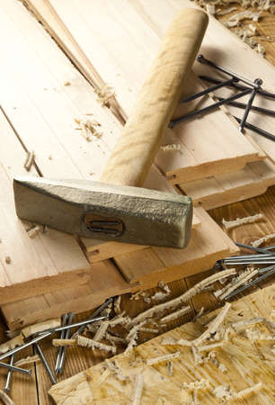 Hammer and nails are on a wooden planks Stock Photo - 13718153