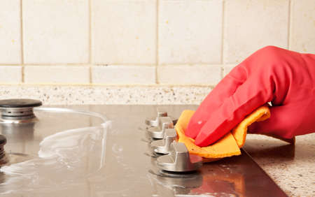 The man cleaning gas stove Stock Photo - 14006017