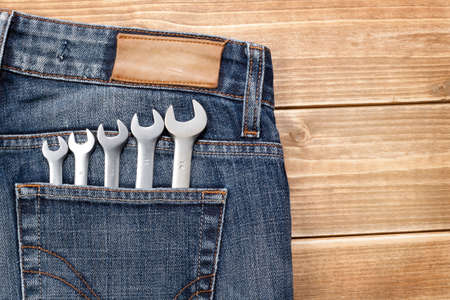 jeans fabric: Wrenches in blue jeans pocket