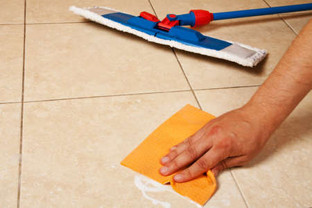 Hand with sponge clean a house floor photo