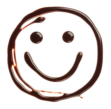 Smiley face made of chocolate syrup is isolated on a white background Stock Photo
