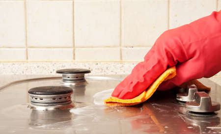 The man cleaning gas stove photo