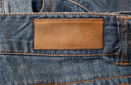 Brown leather jeans label sewed on jeans. photo