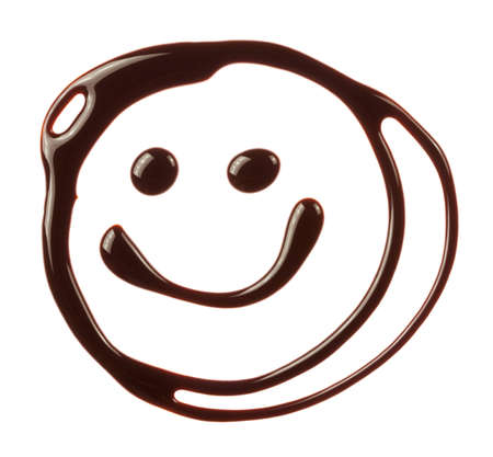 syrupy: Smiley face made of chocolate syrup is isolated on a white background Stock Photo