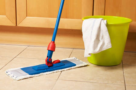 cleaning floor: House cleaning with the mop
