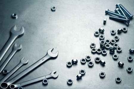 Wrenches, nuts and screws on a metal plate Stock Photo - 14921472