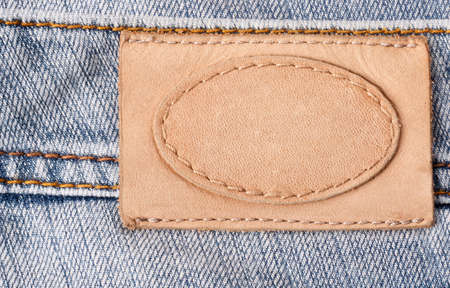 Brown leather jeans label sewed on jeans  photo