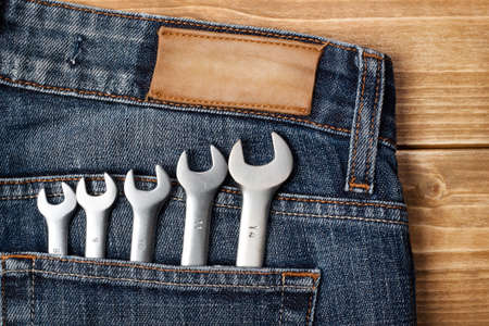 Wrenches in blue jeans pocket photo