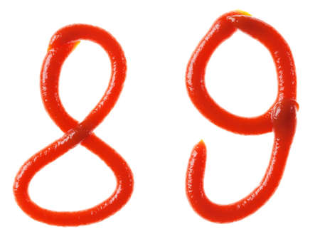 Numbers symbols made from tomato, ketchup syrup are isolated photo