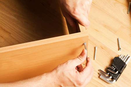 furniture part: Carpenter mounting wooden furniture