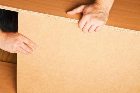 assembling: Carpenter mounting wooden furniture