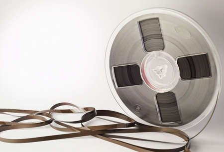 old spools: Vintage magnetic audio reel and tangled tape with space for text