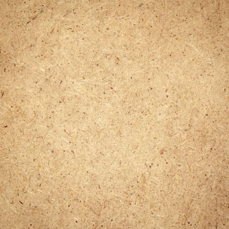 Pressed brown chipboard texture  Wooden background  photo