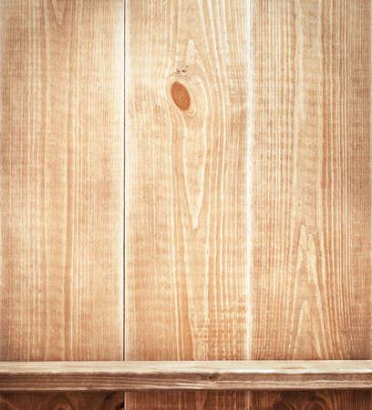 Empty shelf on wooden wall. Wooden texture. photo
