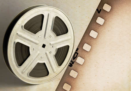 Old motion picture film reel with film strip photo