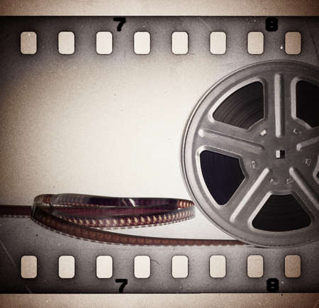 celluloid film: Old motion picture film reel with film strip  Vintage background