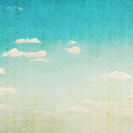 mottled background: Sky and clouds on grunge paper texture Stock Photo