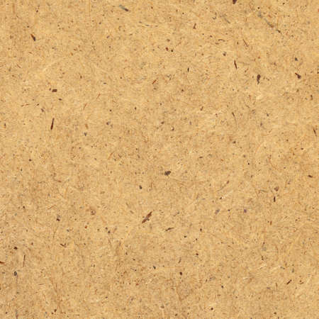 chipboard: Pressed brown chipboard texture. Wooden background. Stock Photo