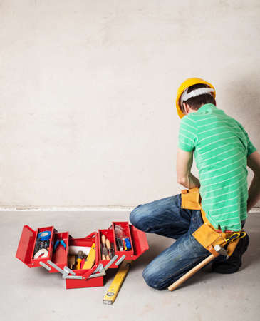 construction worker with toolbox photo