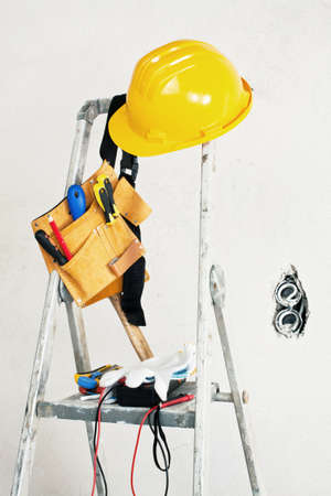 stepladder near the concrete wall and tools photo