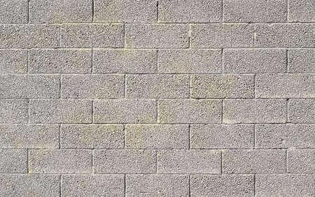 yellow block: cinder block wall background, brick texture