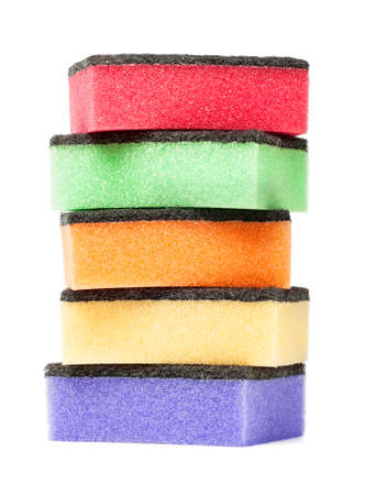 colorful sponges are isolated on a white photo