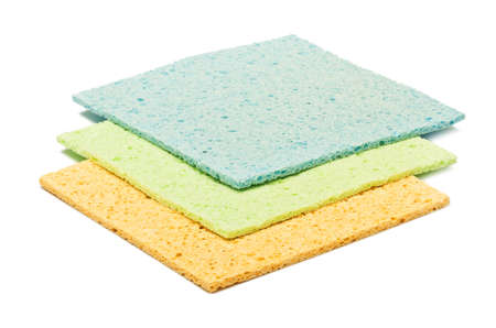 colorful kitchen sponges are isolated on a white photo