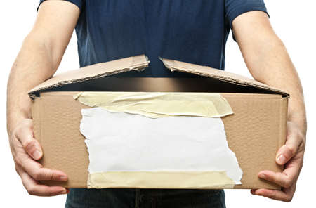man holding old brown box photo