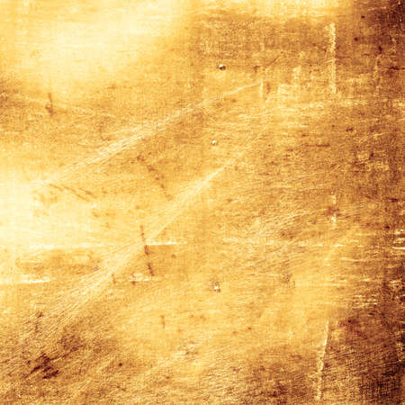 grunge scratched gold metal background photo