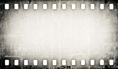back to camera: grunge scratched film strip background