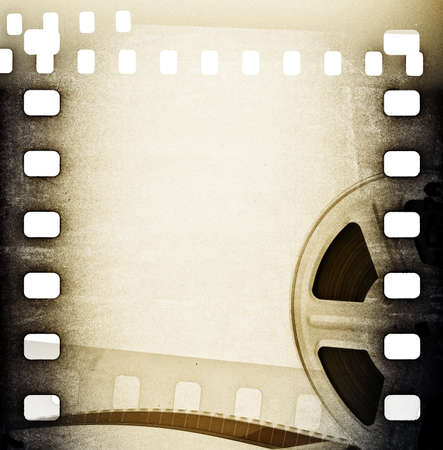 Old motion picture film reel with film strip  Vintage background photo