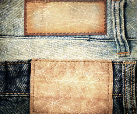 grunge scratched leather jeans label sewed on jeans. photo