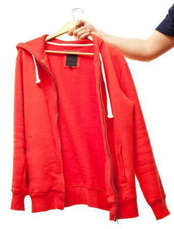 hooded shirt: men hand holding hanger with hooded jumper Stock Photo