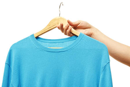men hand holding hanger with t-shirt Stock Photo - 22974579
