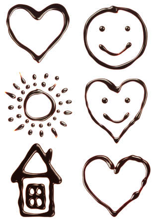 Set of chocolate syrup heart,smile,sun,house photo