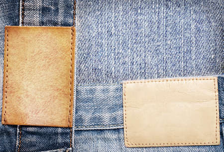 inner wear: Brown leather jeans labels sewed on jeans. Stock Photo