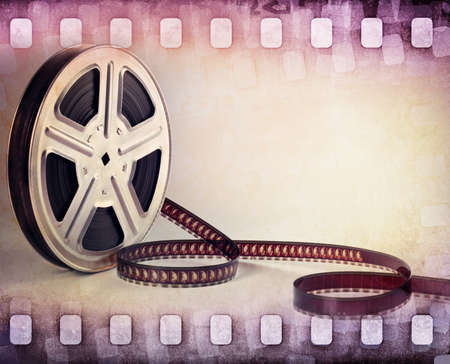 negative graphic: colorful film strip, film reel background