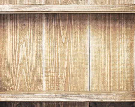 Empty shelfs on wooden wall photo