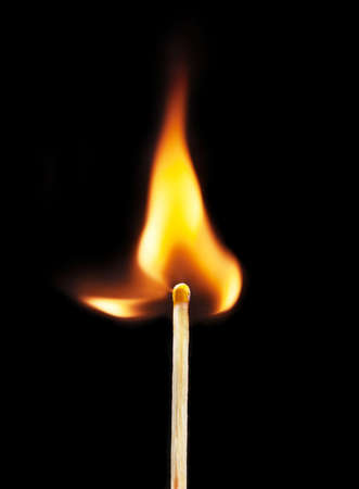 matchstick: burning matchstick on black background