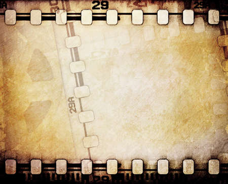 celluloid film: Old motion picture reel with film strip. Stock Photo