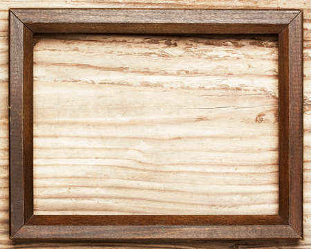 Vintage wooden frame on wood background Stock Photo