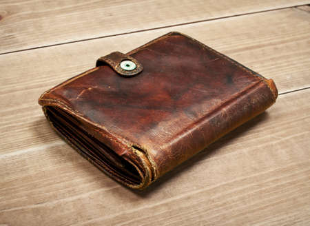 old purse on wooden table Stock Photo
