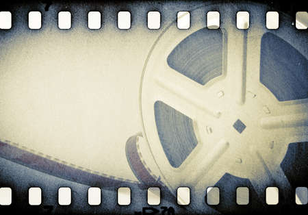 Old motion picture reel with film strip. Stock Photo