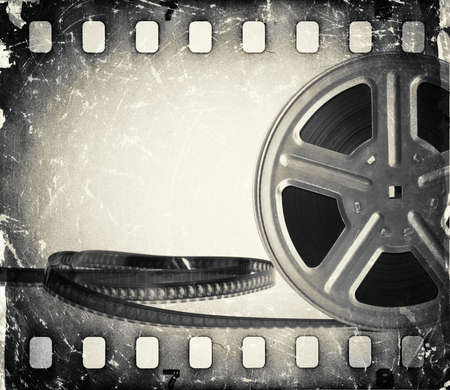 Grunge old motion picture film reel with film strip  Vintage background photo